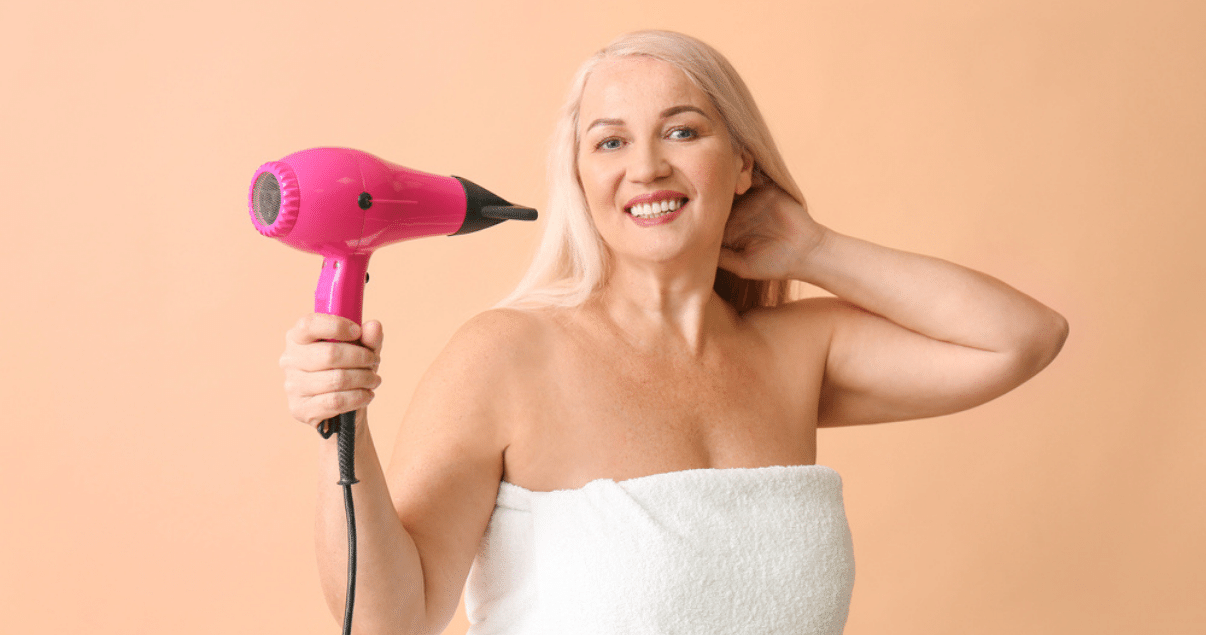 Middle aged woman grooming hair before storing wig