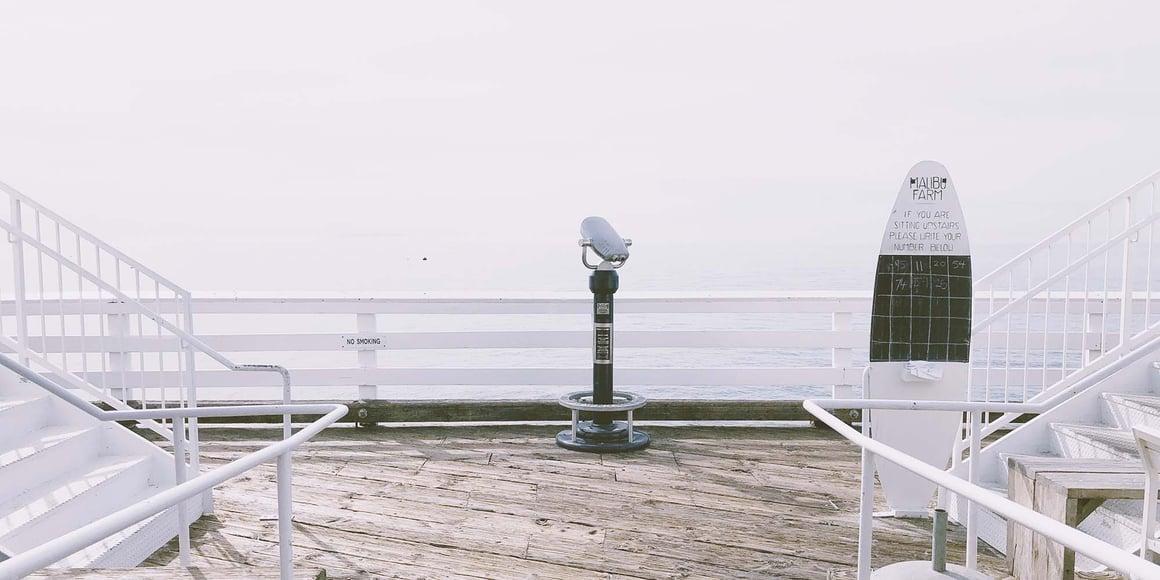 Image of a telescope on a boardwalk