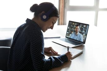 Remote business meeting on laptop