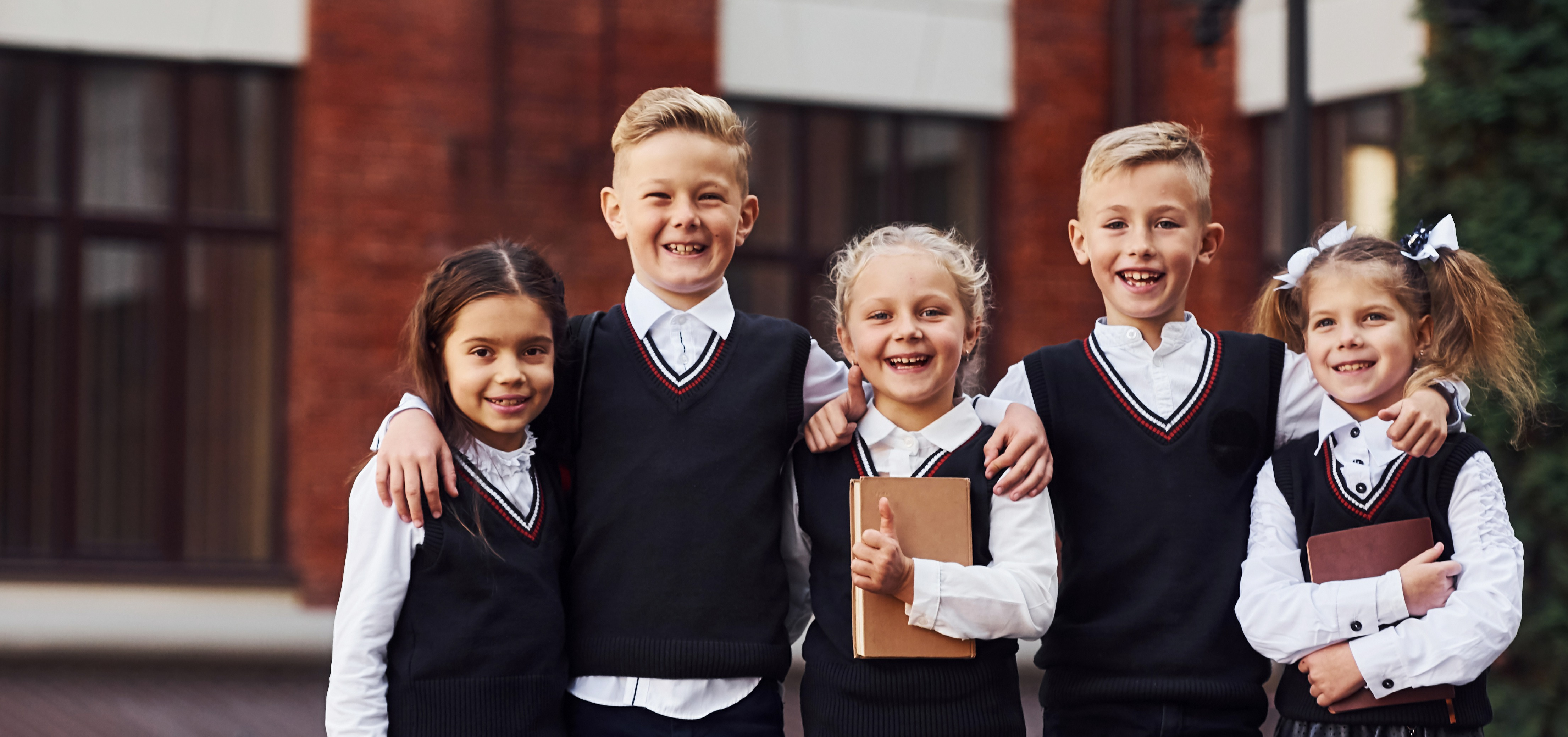 group-of-kids-in-school-uniform-that-is-outdoors-t-XXWHJQS-1