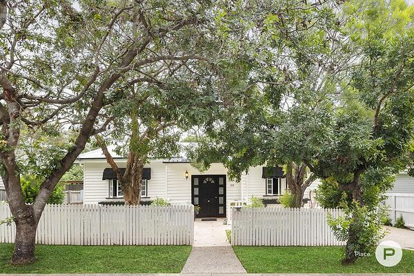 house with garden and white picket fence