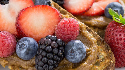 loaded toast with berries