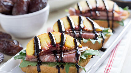 peach proscuitto crostini with medjool date balsamic glaze