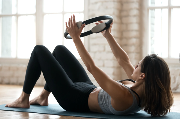 8 Benefits Of Pilates That Prove It's Much More Than A Core Workout
