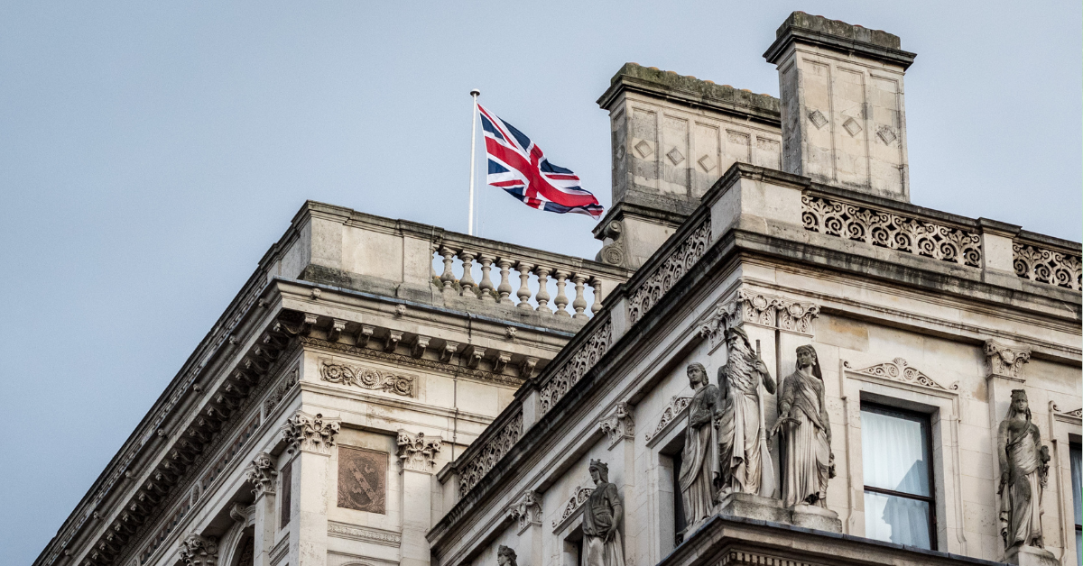A government building in London flying the Union Jack flag