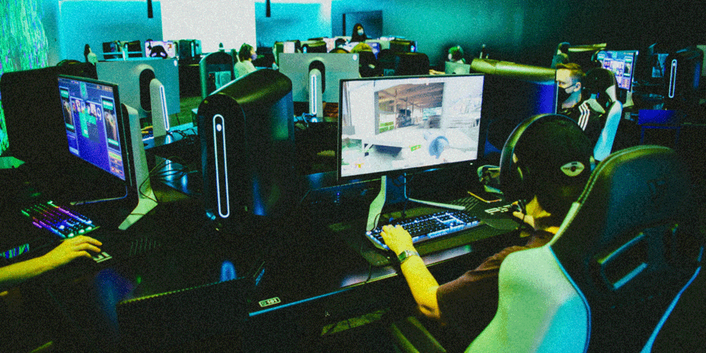 People playing games on computers at Fortress