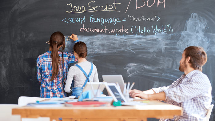 Kids in a classroom learning to code in JavaScript