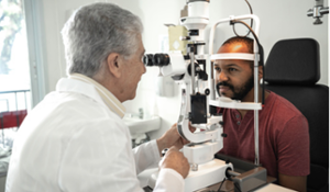 Man at eye exam with Doctor