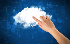 Female hand touching cloud with blue background