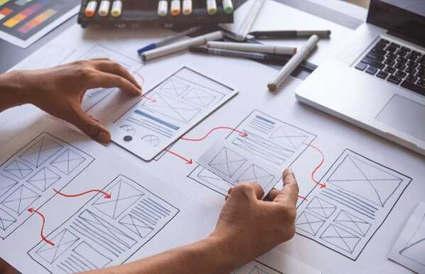 Designer working on a prototype wireframe
