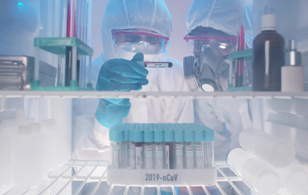 lab workers viewing vaccine vials