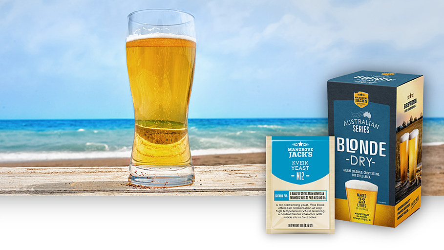 Mangrove Jack's Kveik Yeast with Blonde Dry kit on a beach with a beer glass