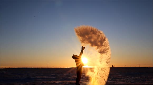 Person throwing water in the air