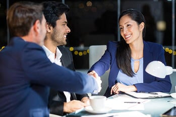 Businessman shaking hands with a female hire