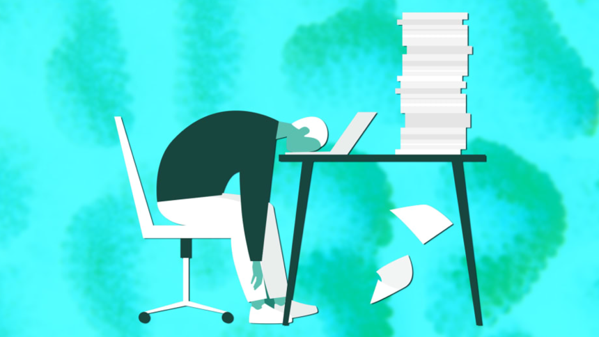 Person sitting at desk with stack of papers