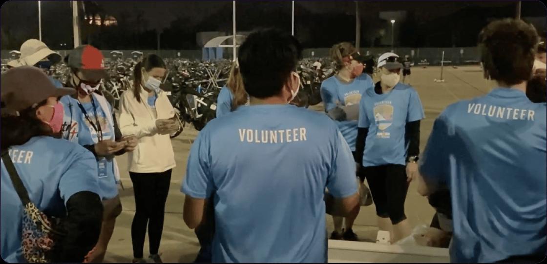 A volunteer huddle at IRONMAN 70.3 Texas.