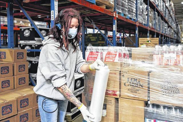 A SpartanNash employee packing goods