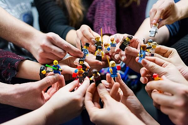 Digital champions league of intranet influencers - lots of LEGO people in a group