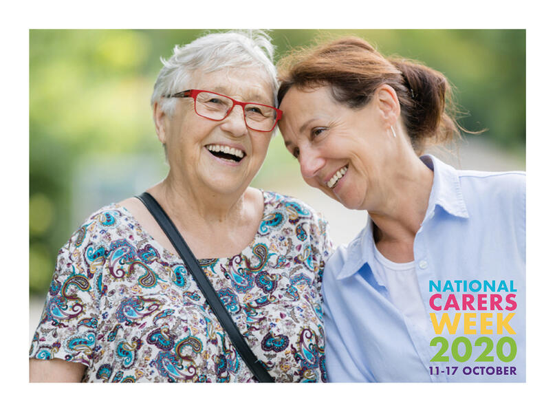 Two carers smiling together