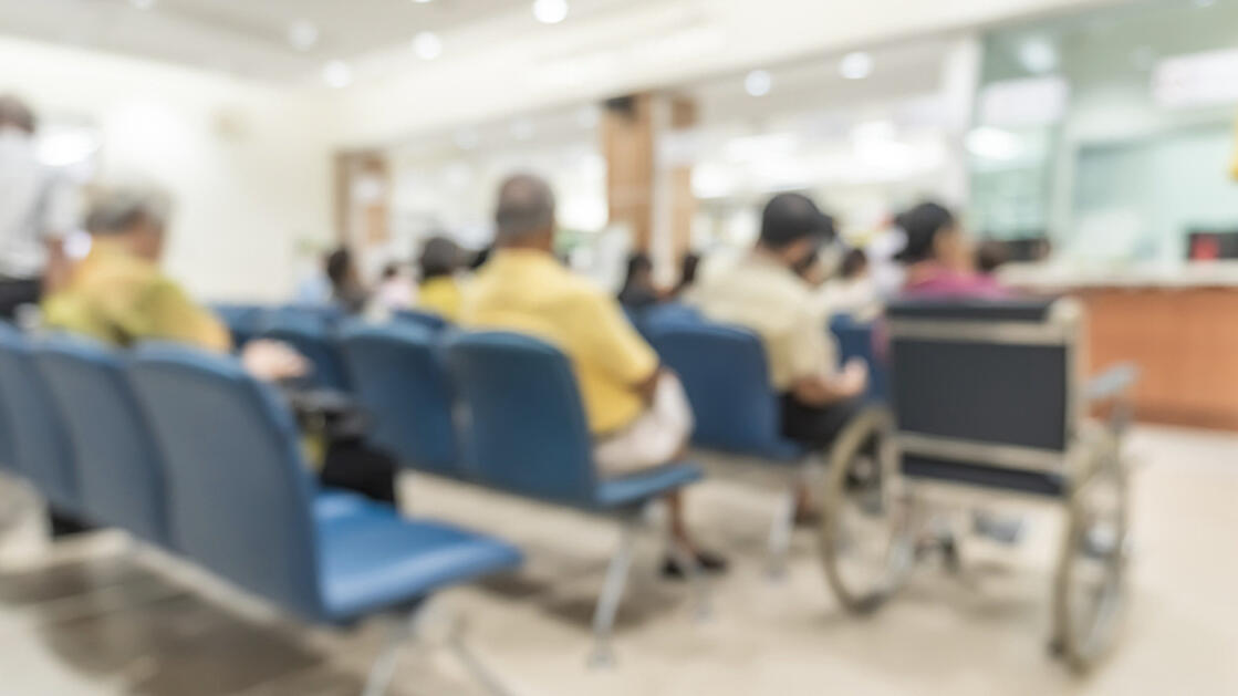 Blurred image of people waiting in an Emergency Department