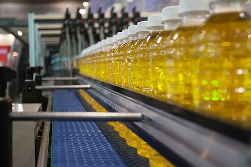 Images of yellow water bottles on assembly line