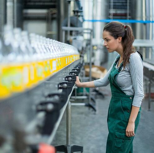 women analyzing production line