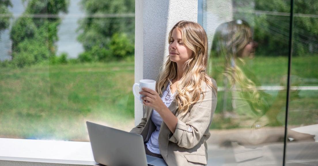 Woman employee closing eyes during a break
