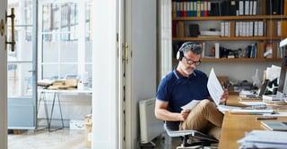 Man doing work with headphones on.