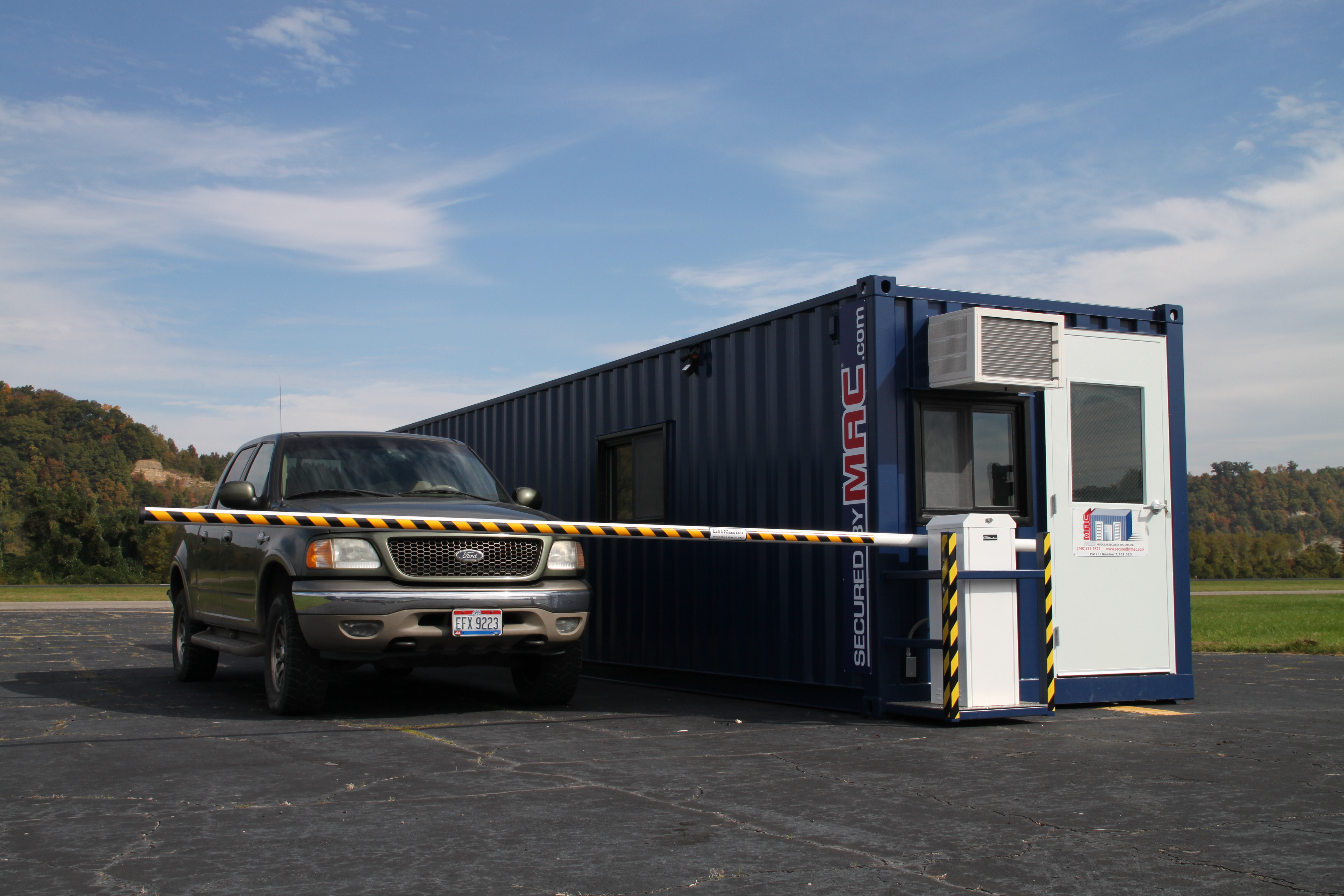 portable guard house with vehicle barrier arms, modular vehicle barrier arms with a guard house, guard office with vehicle barrier arms