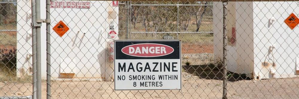 Danger sign on metal gates