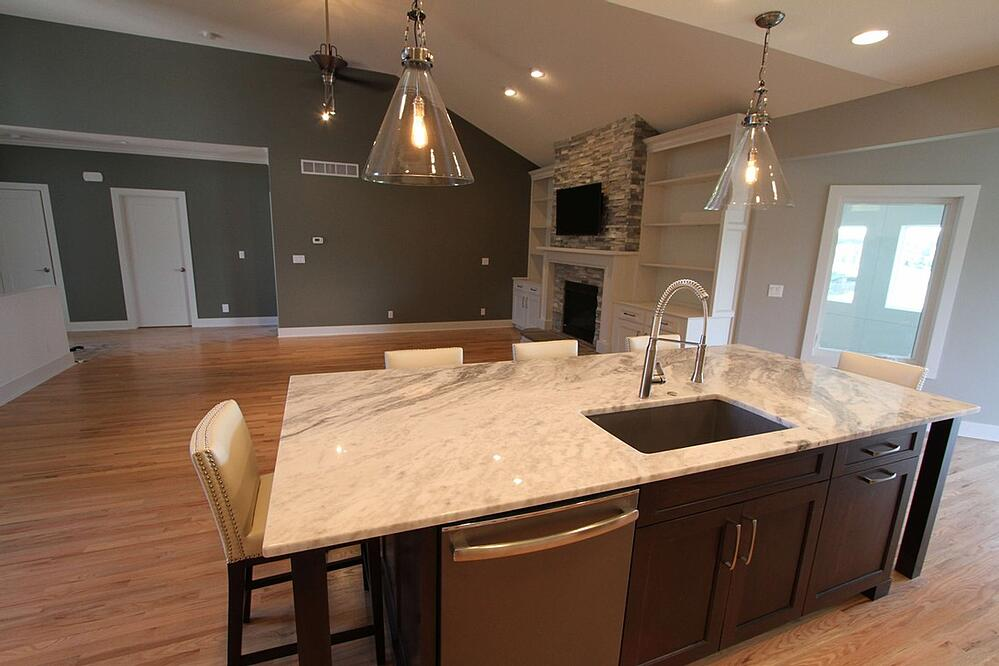 Massive kitchen granite island in this home remodel