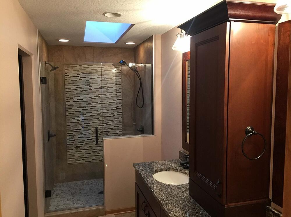 Remodeled bathroom with tiled shower