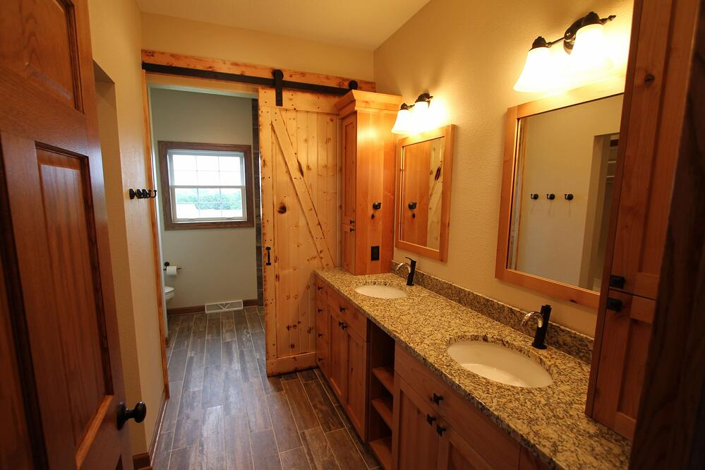 Awesome barn door in this master bathroom remodel