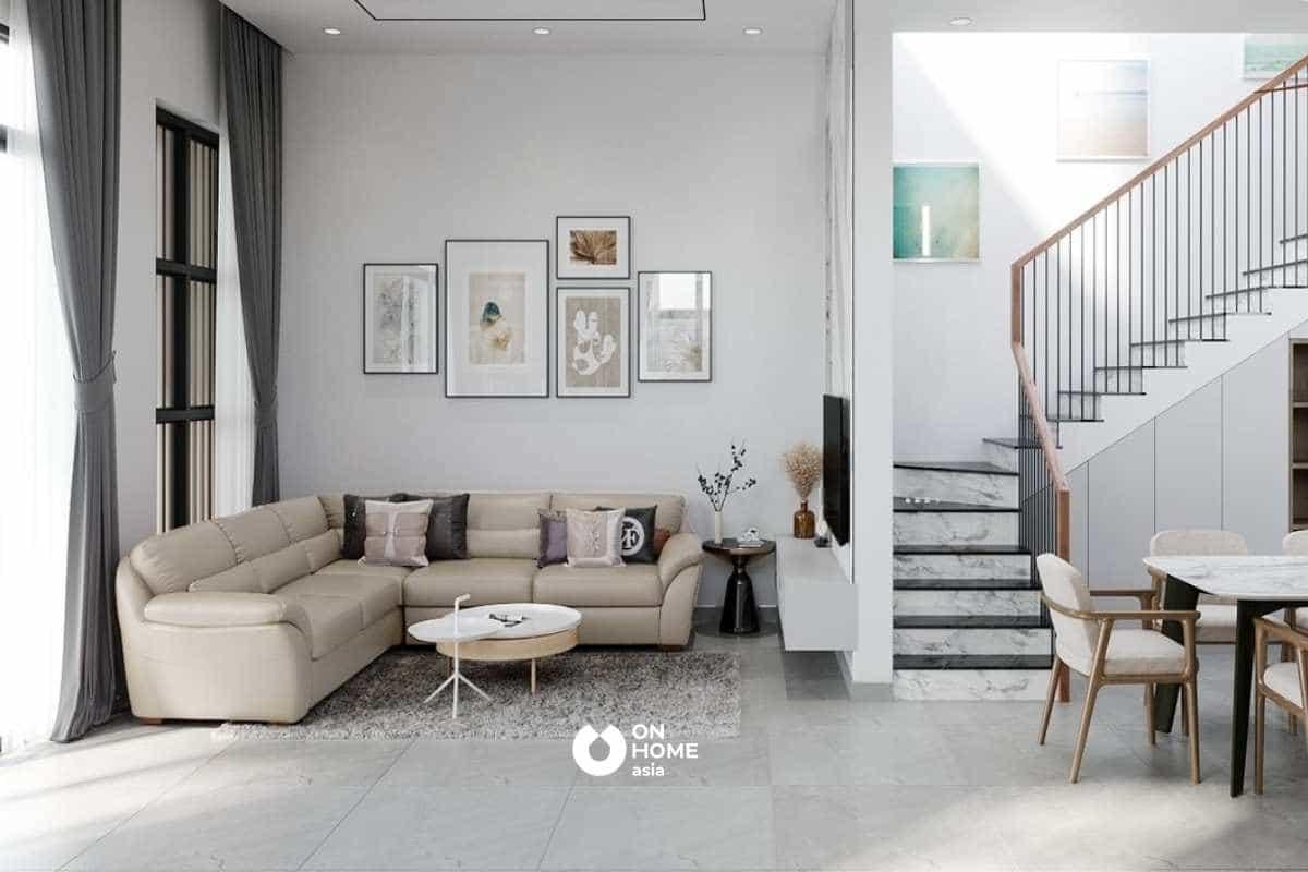 Bộ sofa sáng màu góp phần tạo sự cân bằng và ấm cúng cho tổng thể không gian phòng khách