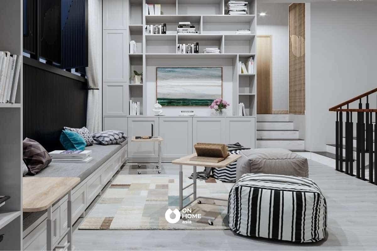 Tận dụng màu sắc từ kệ sách và rèm cửa đồng bộ với màu của căn phòng khiến không gian được mở rộng thêm