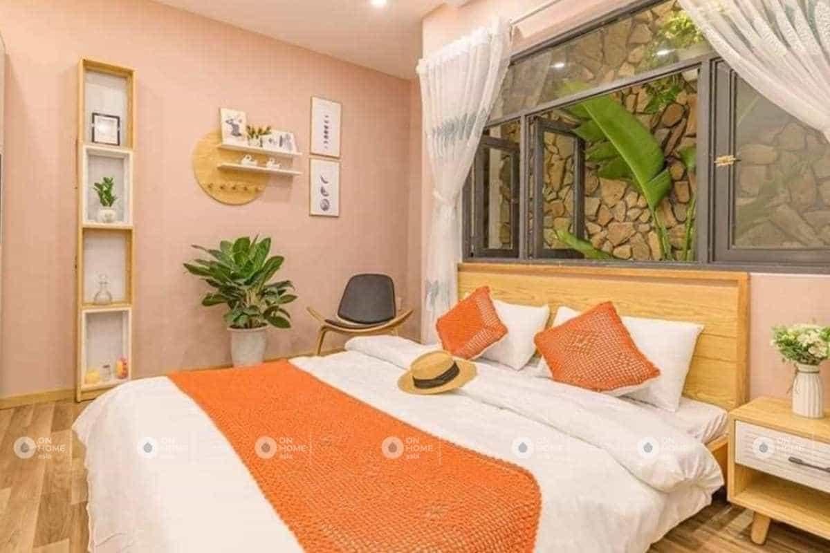 Thiết kế nội thất phòng ngủ với sắc cam nổi bật