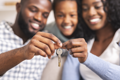 black family holding key new house