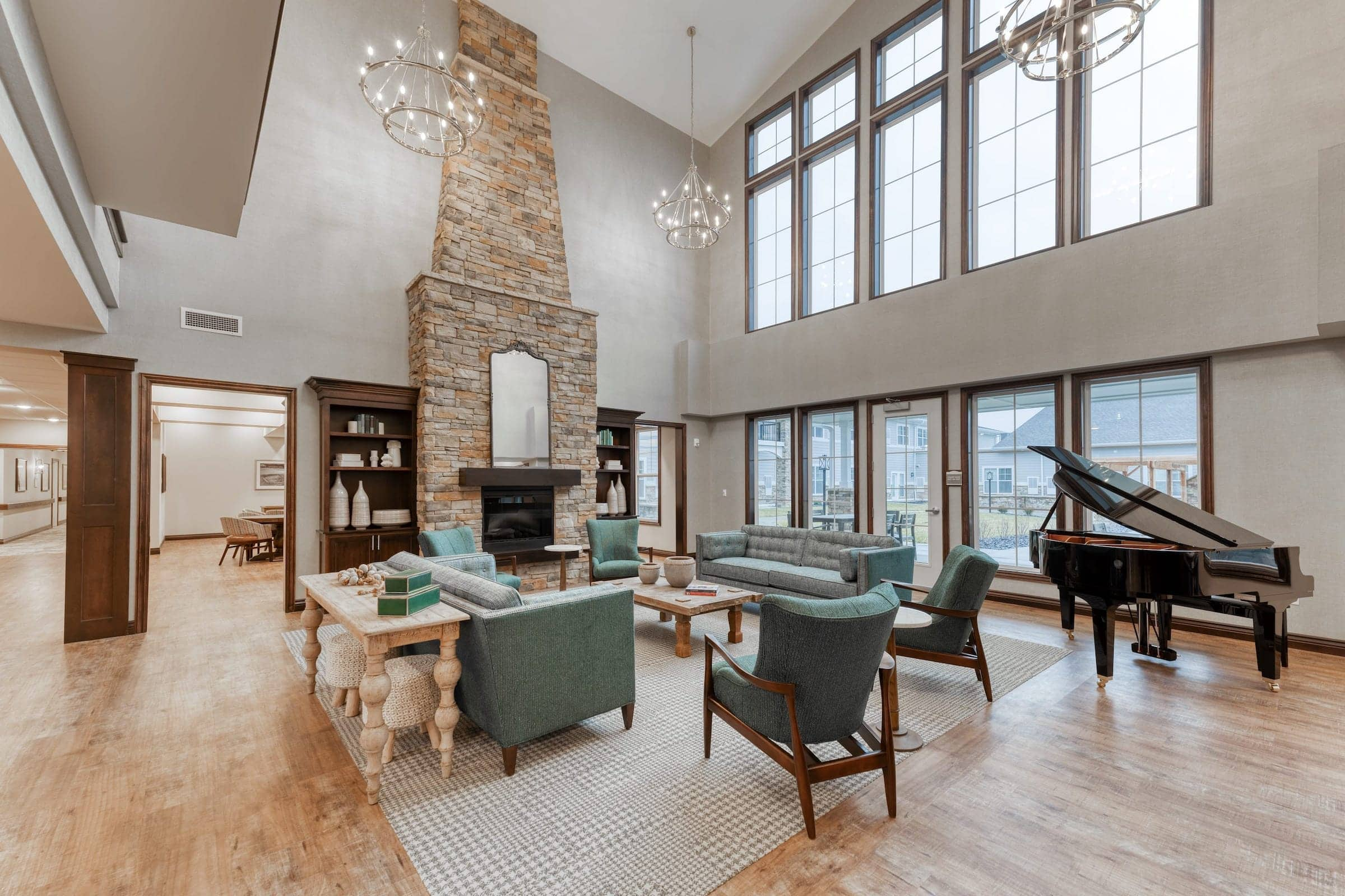 Open community space featuring a stone fireplace and communal piano