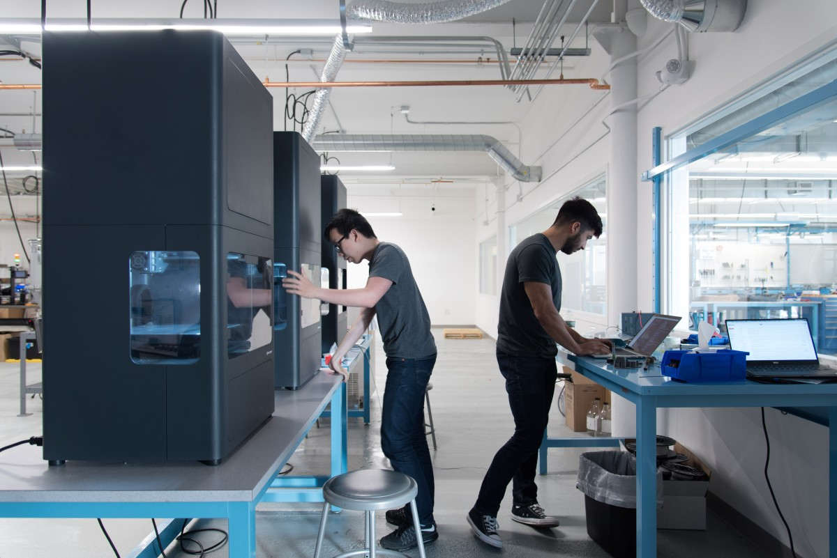 Two men working with Markforged 3D Printers - TPM