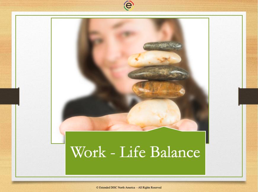 Work - life balance woman balancing a stack of rocks in hand