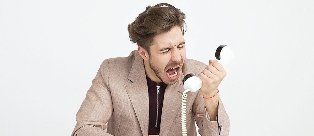 Angry man on phone to dealership