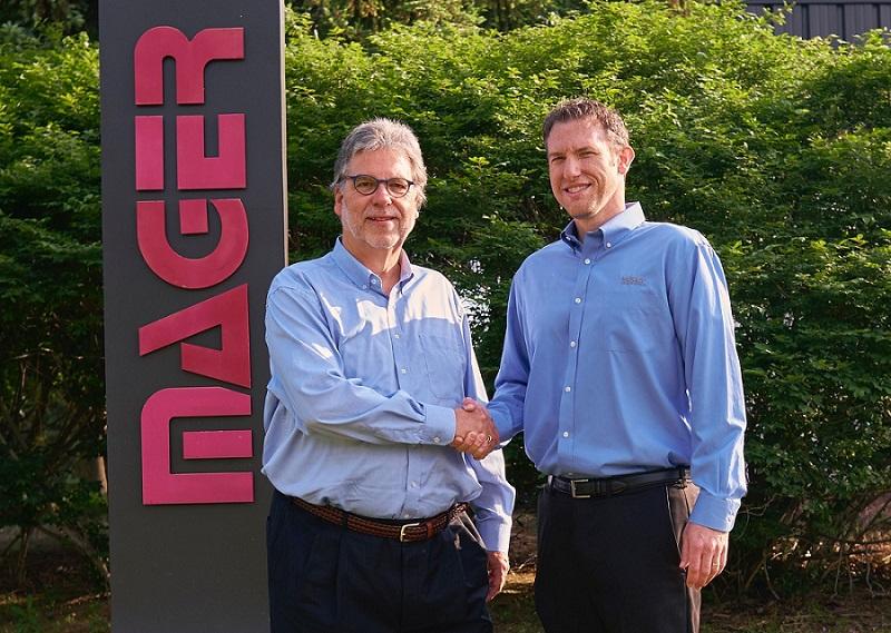 Georg Schick and Jarrad Lawlor shake hands