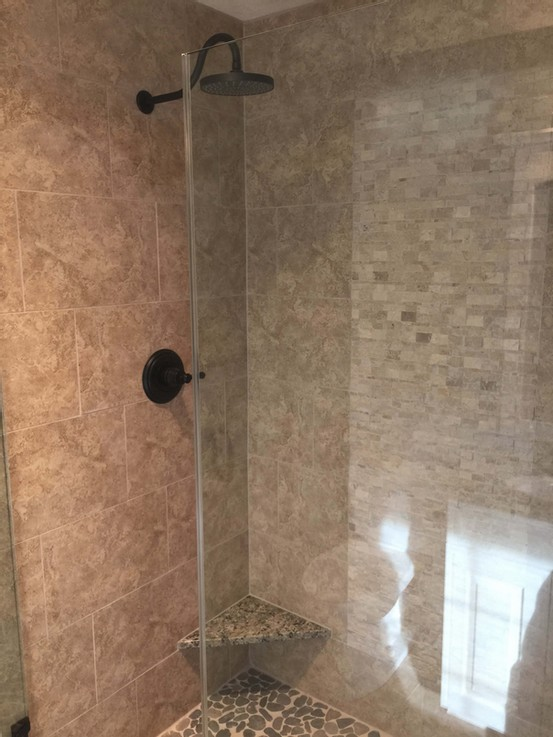 Remodeled tile shower with tile design
